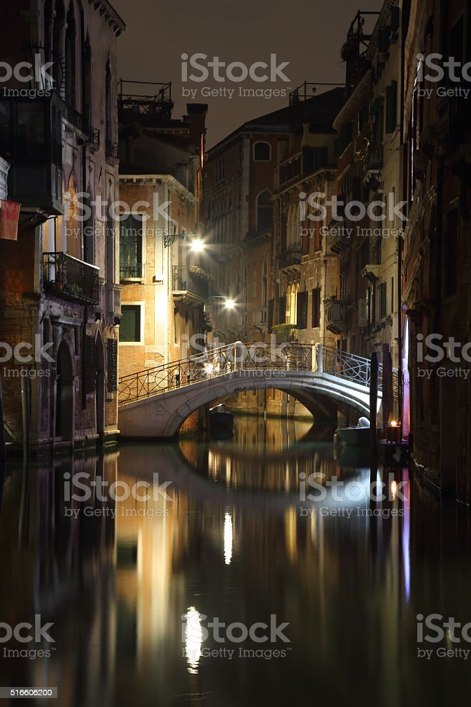 Venice - canal and brigde by night stock photo