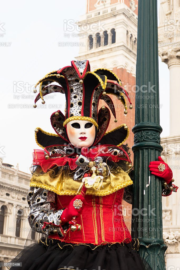 Venice Carnival costume in front of St. Mark's Campanile stock photo