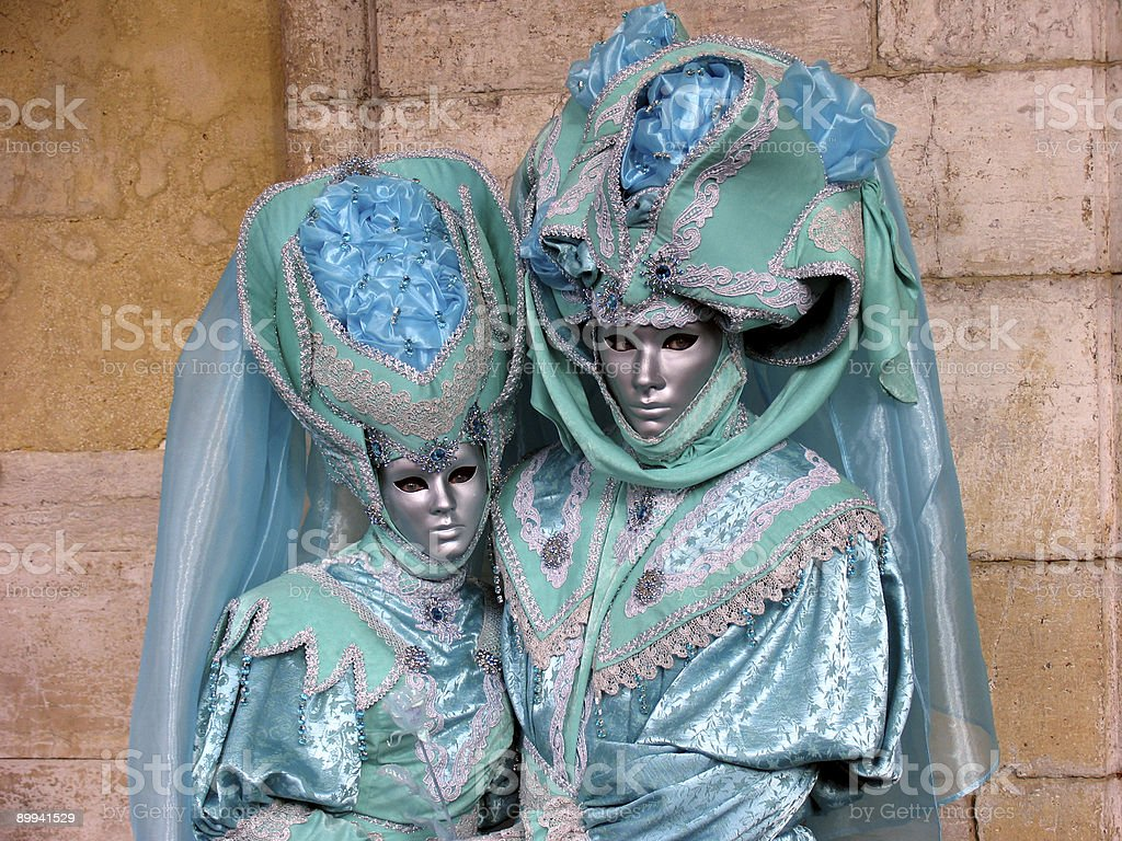 Venice Carnival: Couple in turquoise costumes royalty-free stock photo