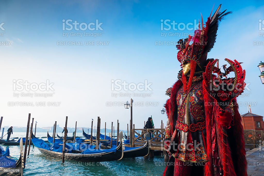 Venice Carnival in front of gondolas dock stock photo