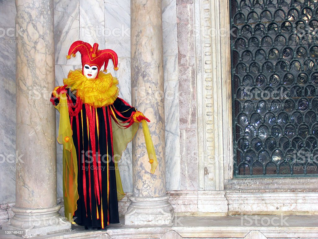 Venice Carnival: mask between pillars 2 stock photo