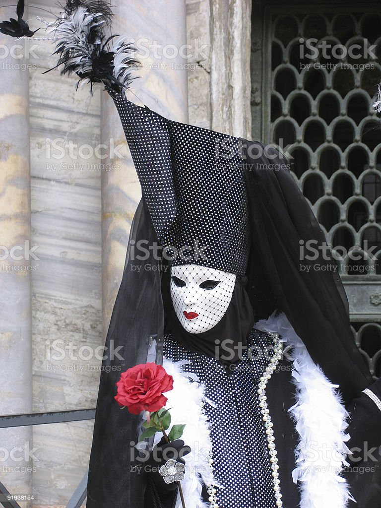 Venice Carnival: mask holding rose royalty-free stock photo