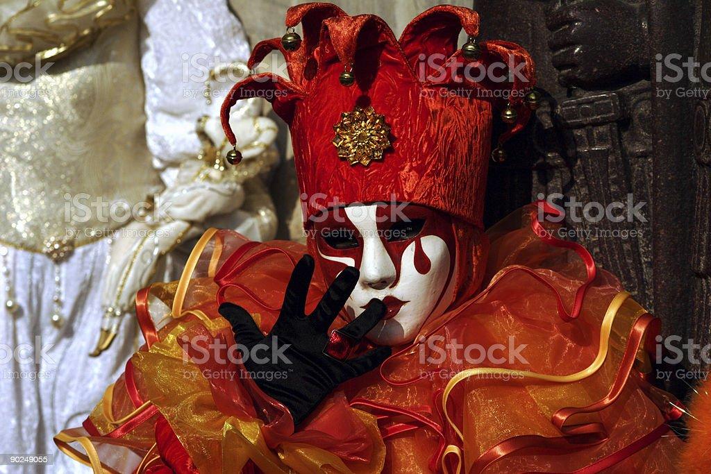 Venice carnival - orange jester costume royalty-free stock photo