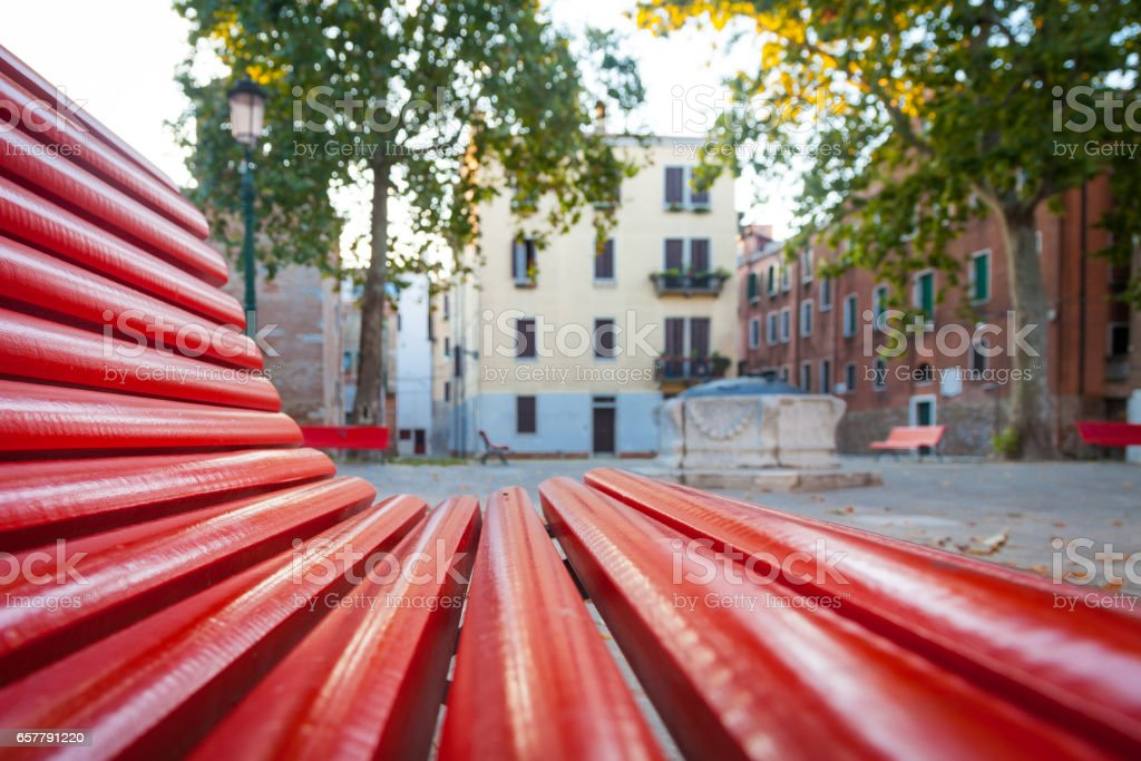 Venice from a red bench stock photo