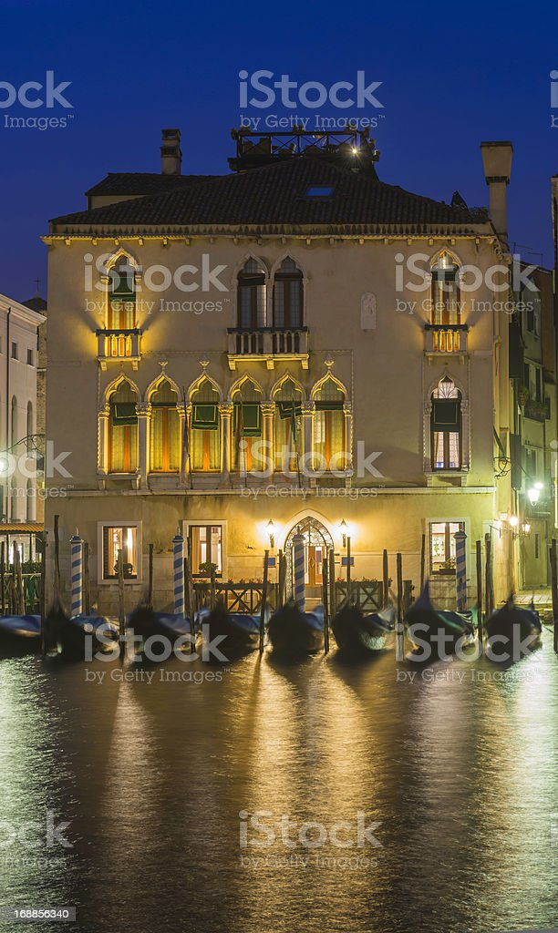 Venice gondolas and palazzo on Grand Canal at dusk Italy royalty-free stock photo