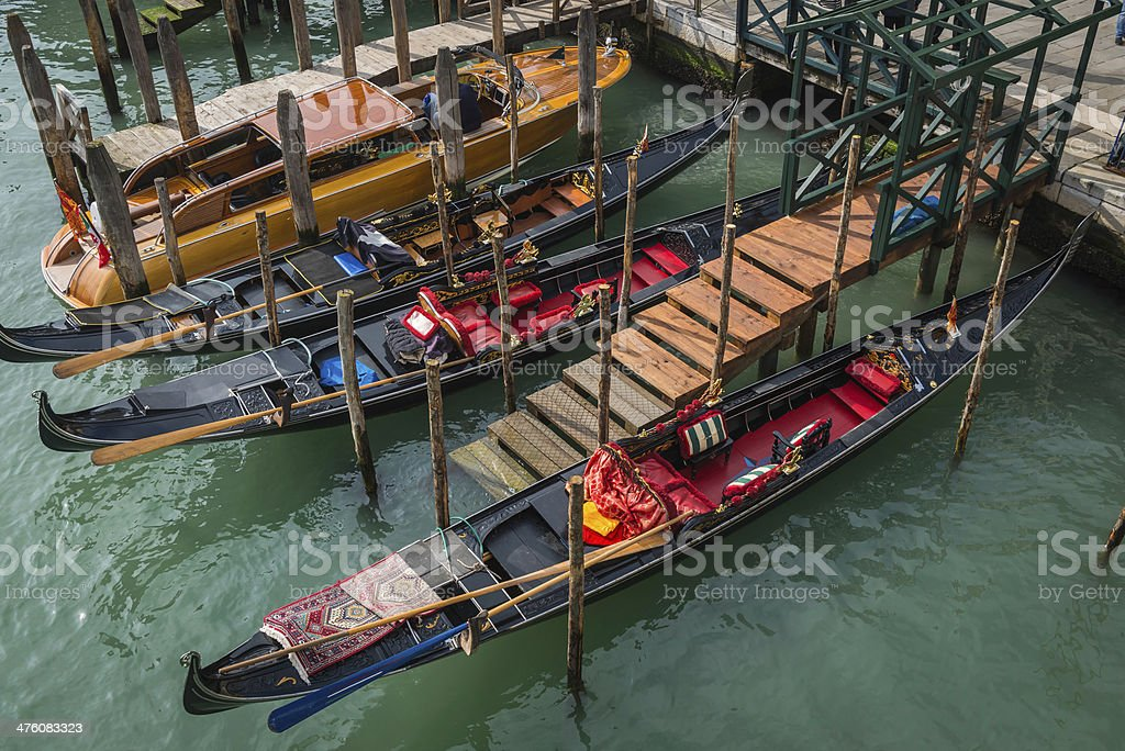 Venice gondolas and water taxi moored on Grand Canal Italy royalty-free stock photo