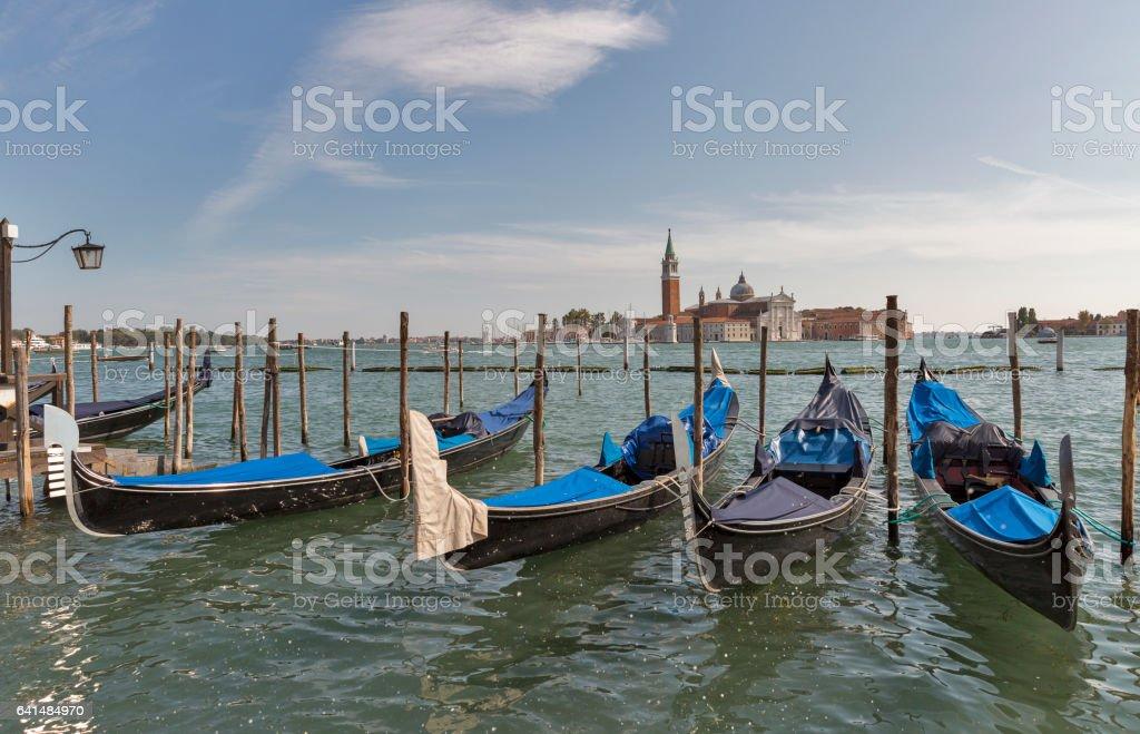 Venice gondolas in front of San Giorgio Maggiore island, Italy. stock photo