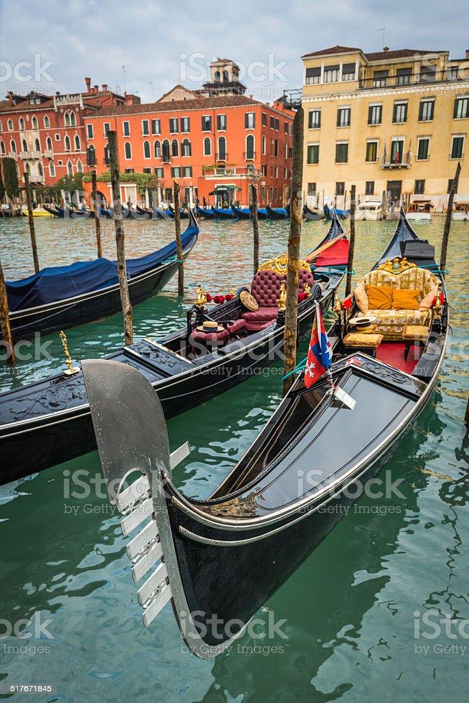 Venice gondolas moored on the Grand Canal at Rialto Italy stock photo