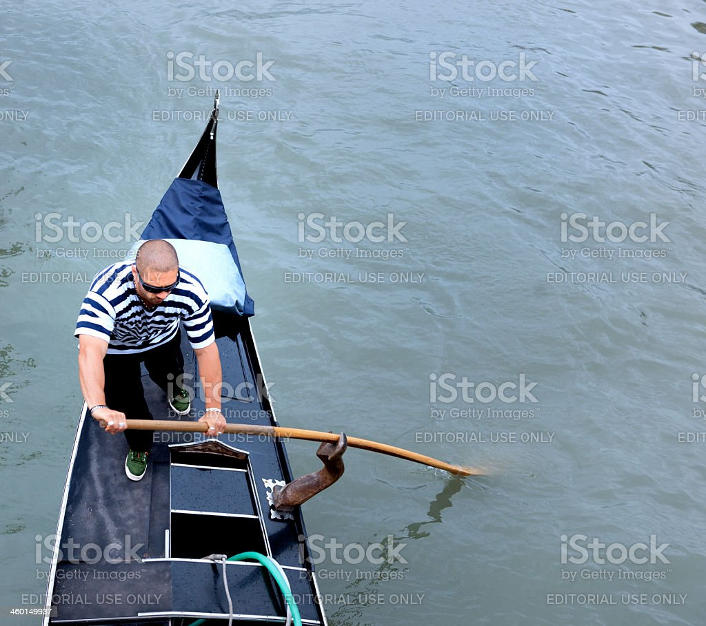 Venice gondolier in grand canal stock photo
