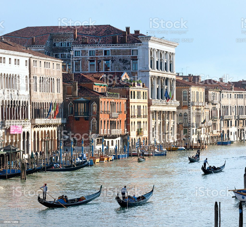 Venice gondoliers in grand canal stock photo