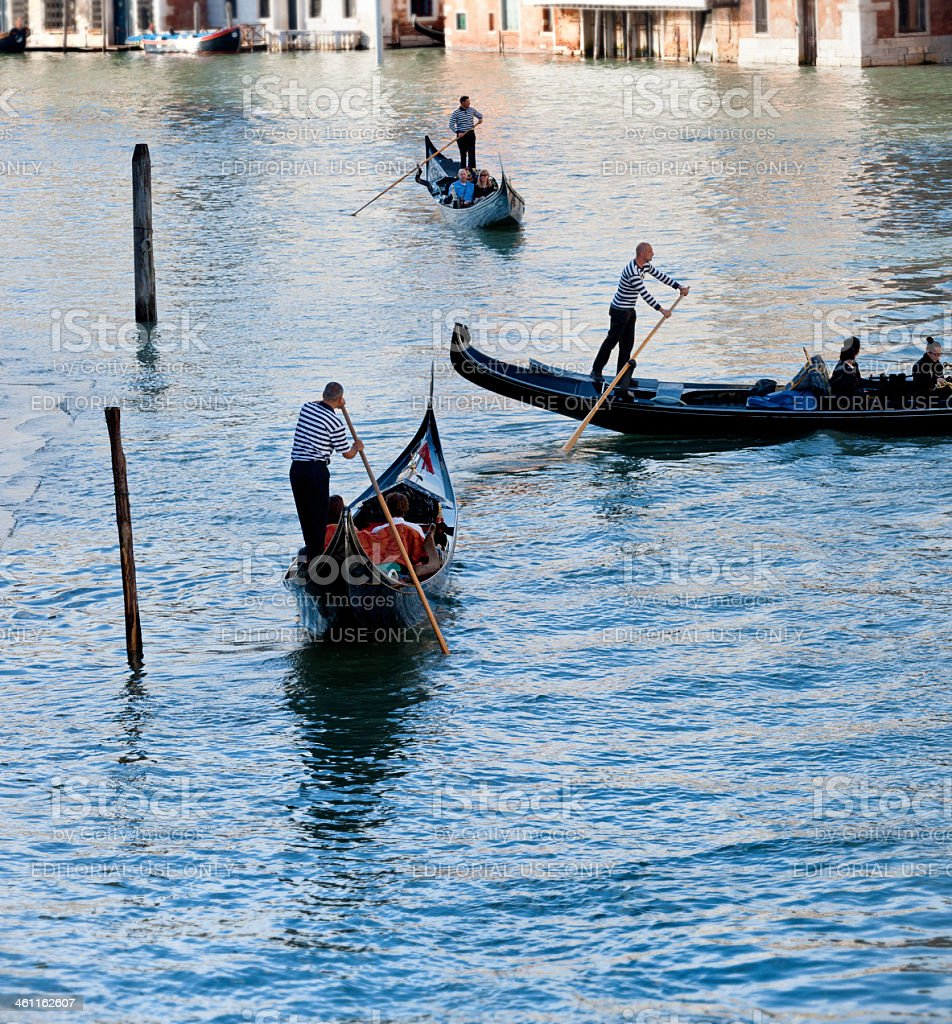 Venice gondoliers in grand canal royalty-free stock photo