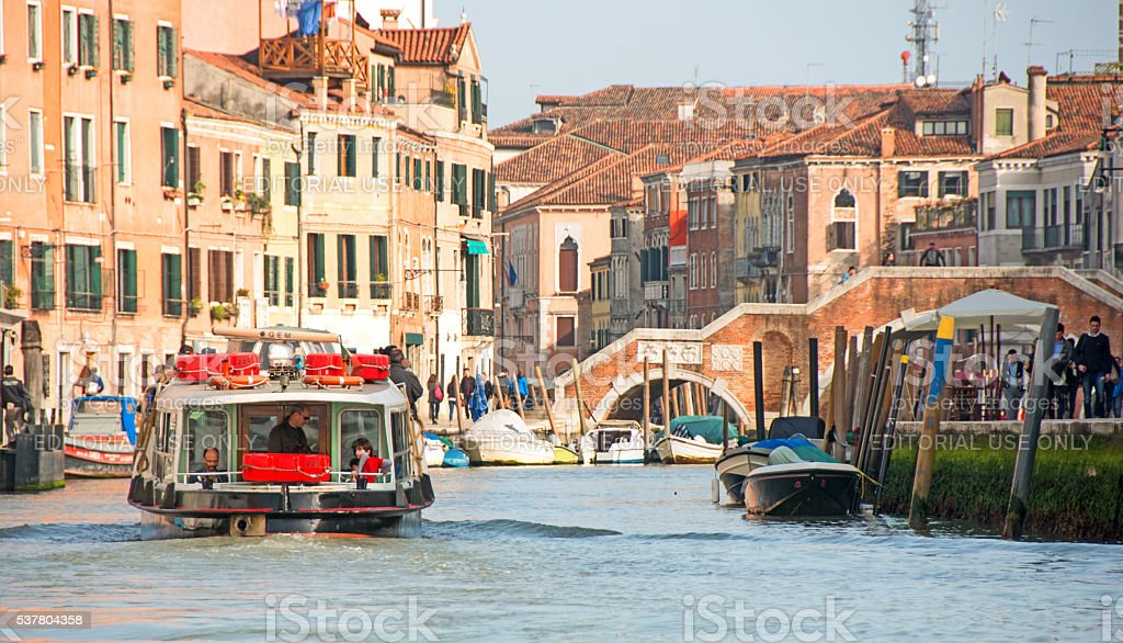 Venice Grand Canal showing palaces, homes, vaporettos, bridge stock photo