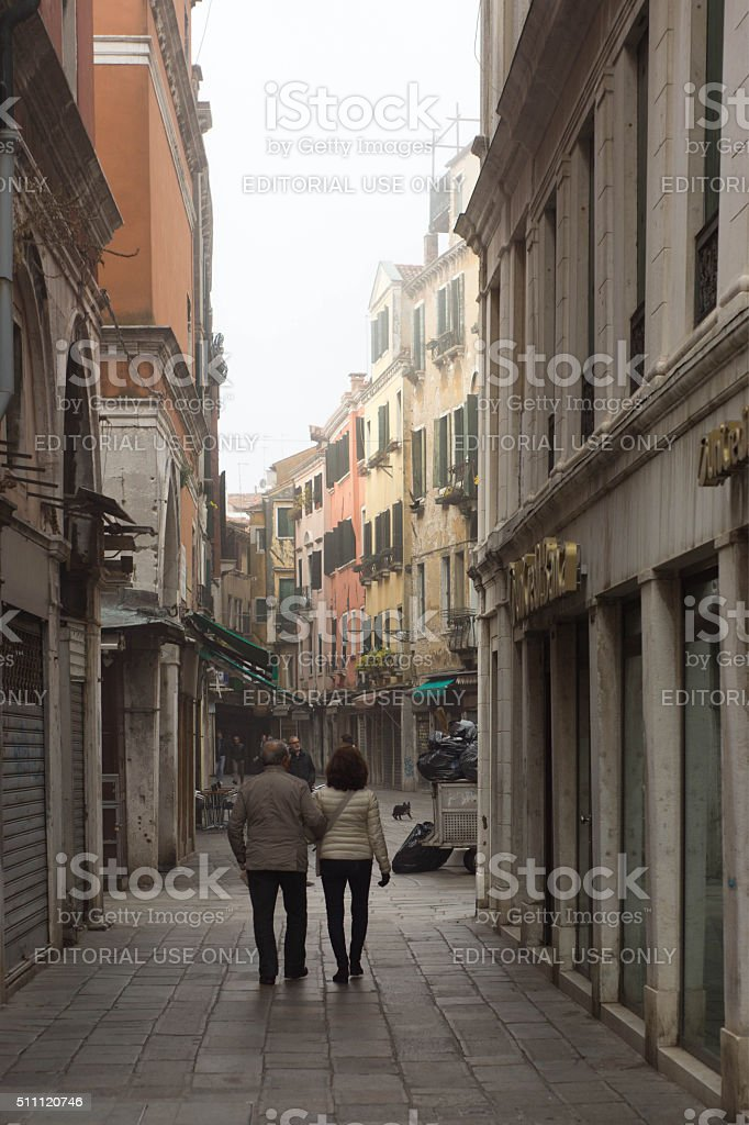 Venice Grand Canalside street in early morning mist stock photo