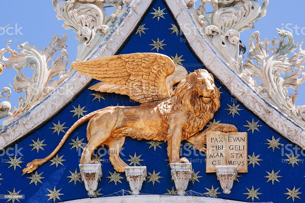 Venice Italiy, Winged golden lion in St. Mark Cathedral stock photo