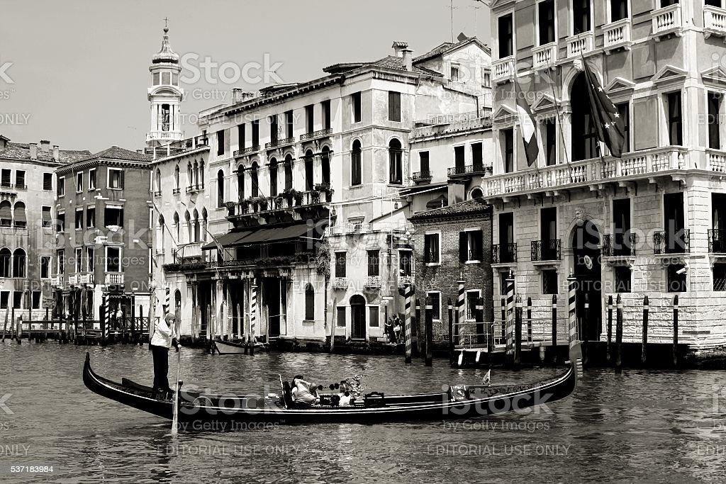 Venice Italy Gondola across Grand Canal Gondolier Tourists stock photo