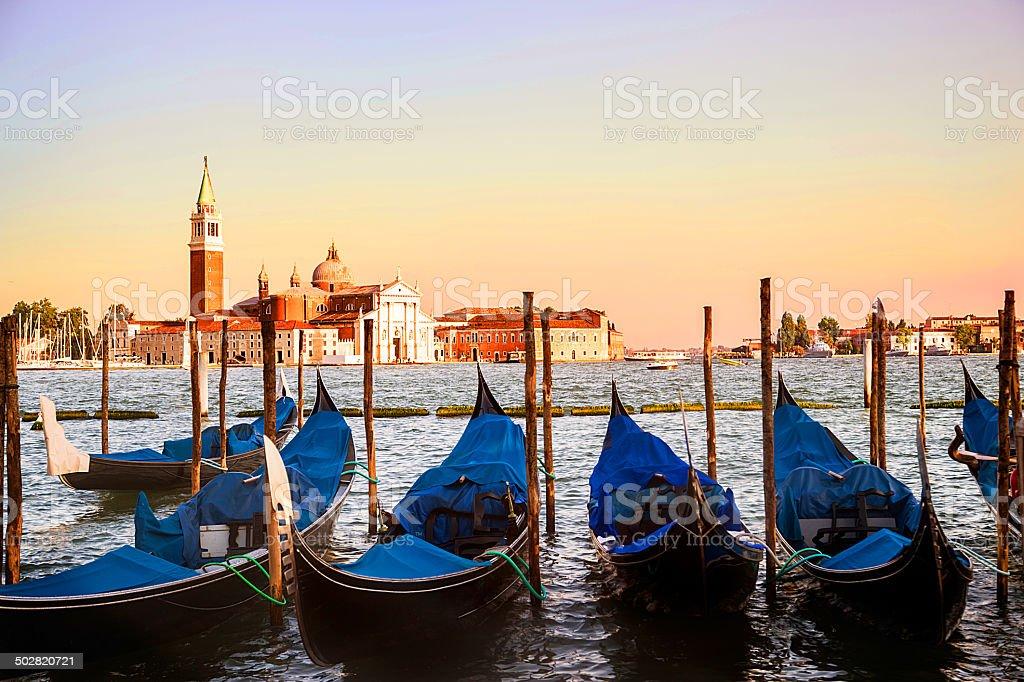 Venice Italy. Gondola boats with the church and ocean. stock photo