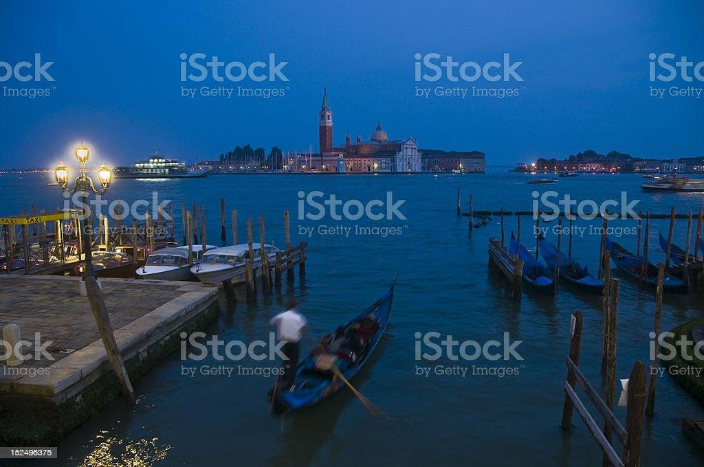 Venice, Italy. Gondolas and San Giorgio Maggiore at Night. stock photo