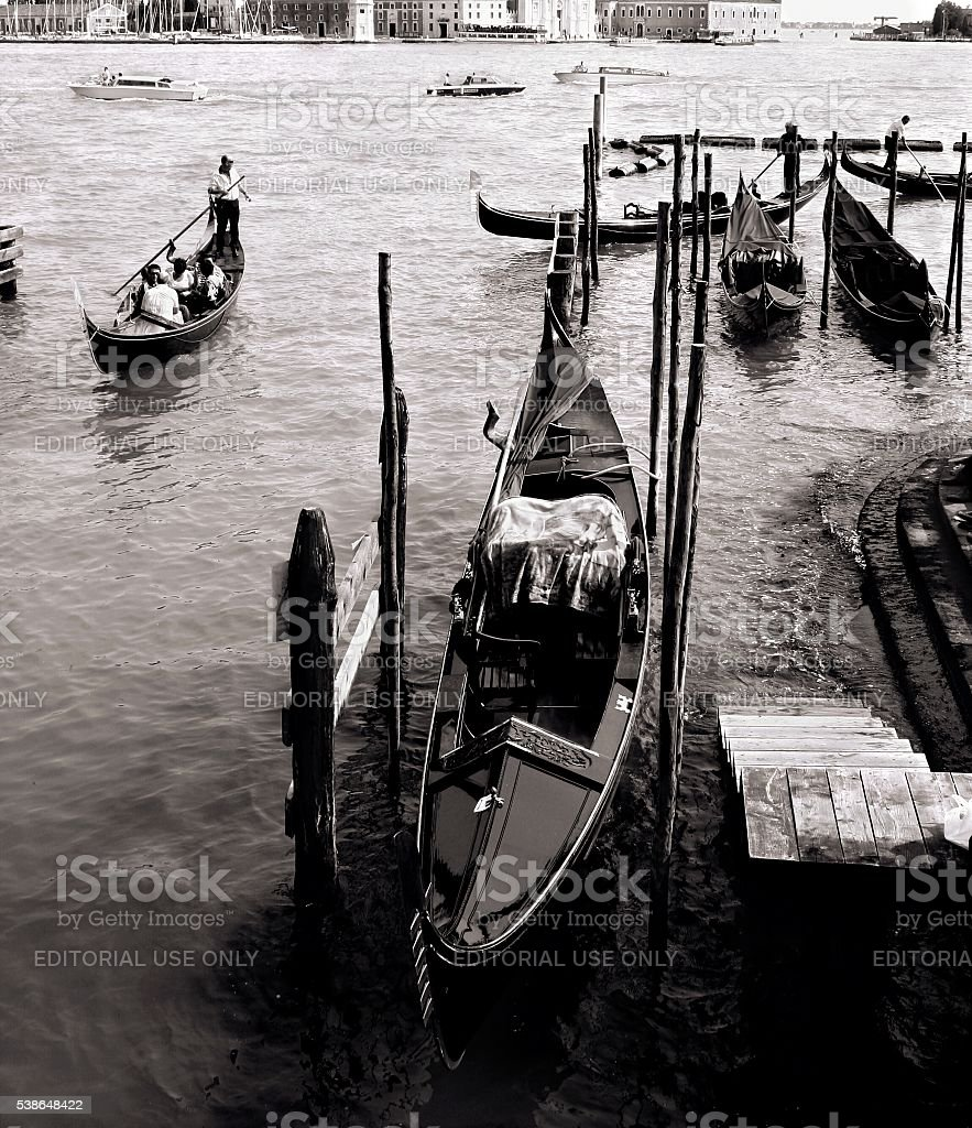 Venice Italy Gondolier Grand Canal Anchored Gondolas Black White stock photo