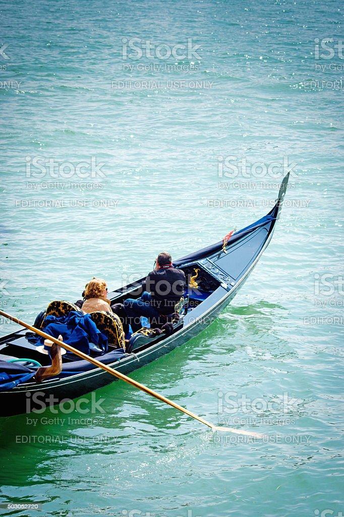 Venice lagoon with close up of gondola at sunrise stock photo