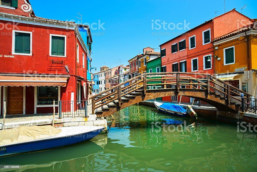 Venice landmark, Burano island canal, bridge, colorful houses an stock photo