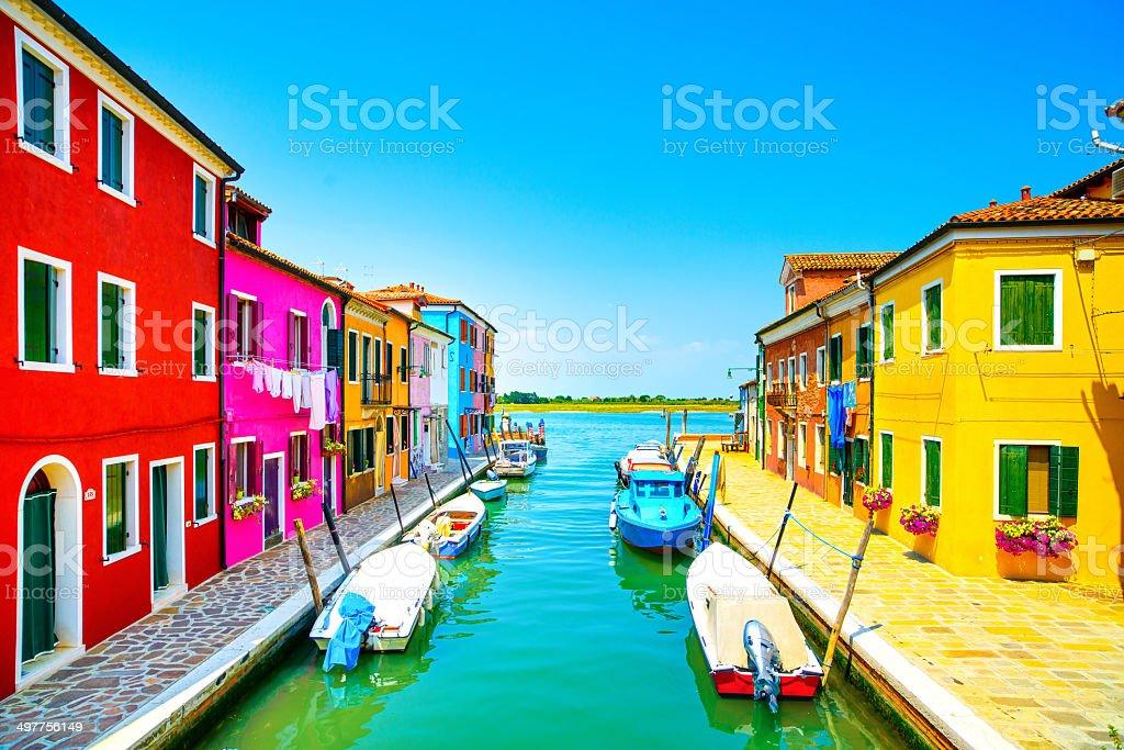 Venice landmark, Burano island canal, colorful houses and boats, stock photo