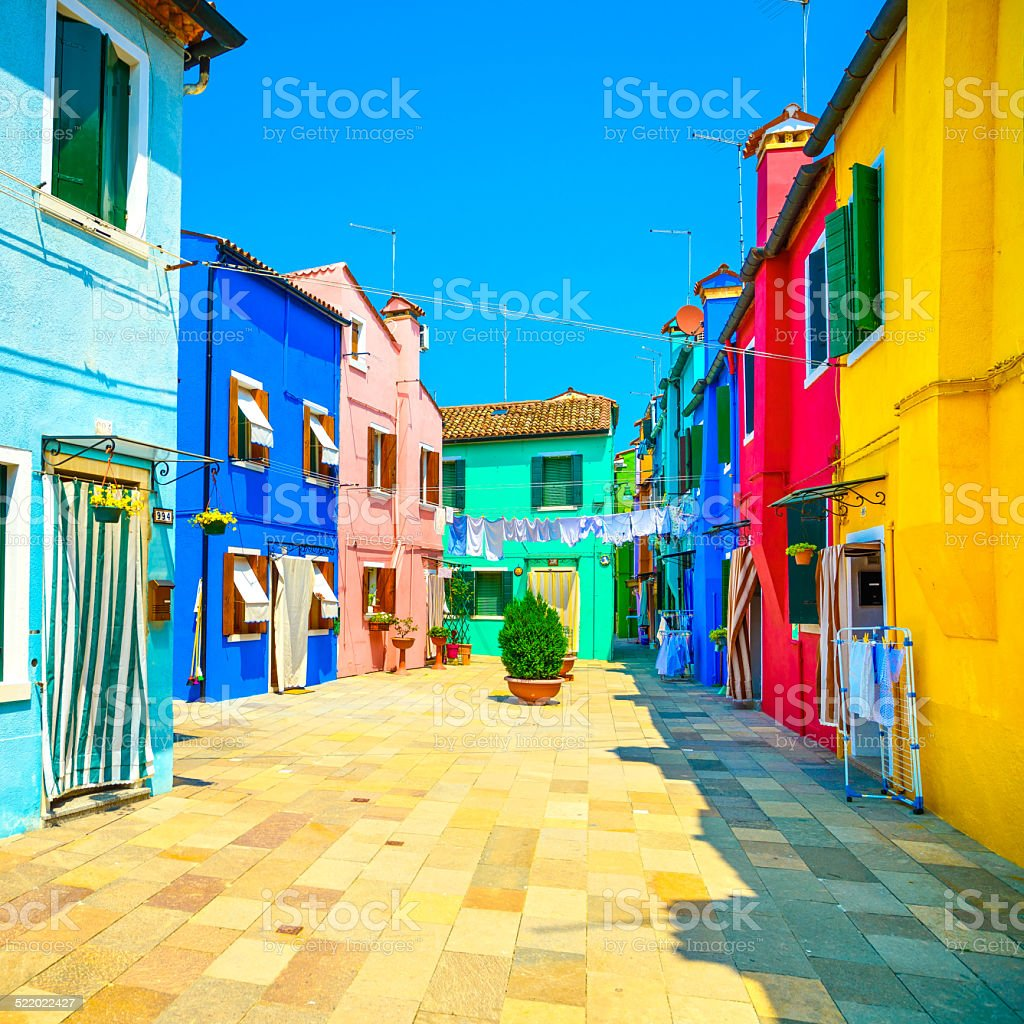Venice landmark, Burano island street, colorful houses, Italy stock photo