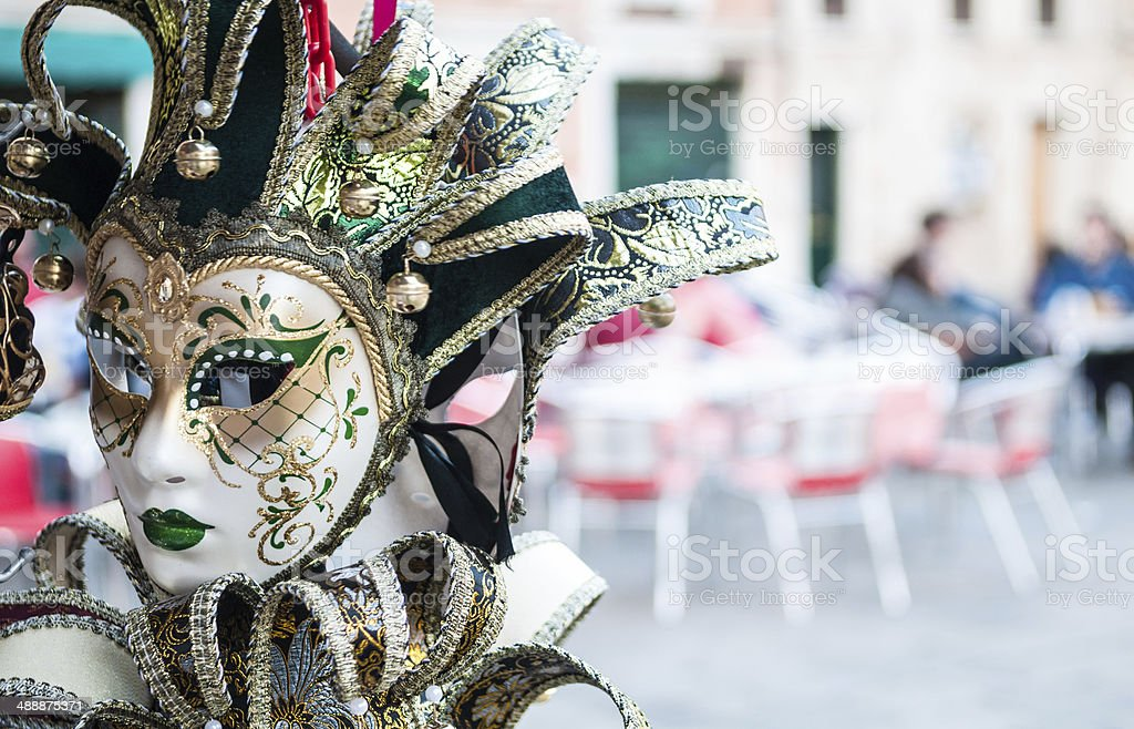 Venice mask sold in a street market stall royalty-free stock photo