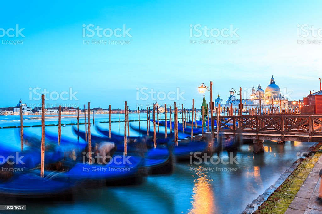 Venice night scene with gondolas and St. Maria Salute Basilica royalty-free stock photo