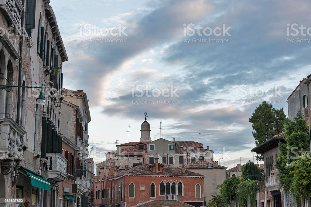 Venice old architecture at sunset with dramatic sky, Italy. stock photo