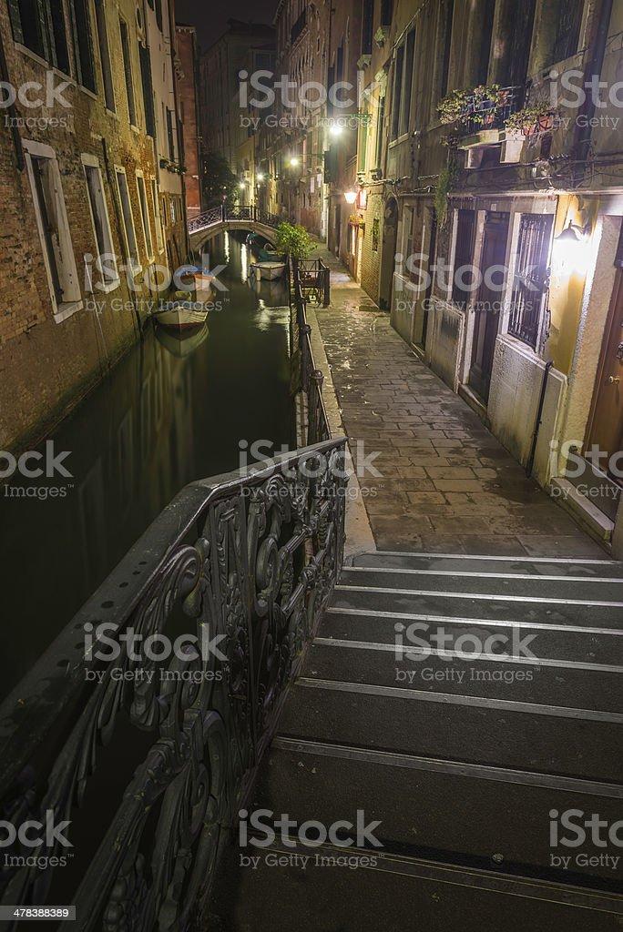 Venice quiet canal bridges stucco villas illuminated at night Italy royalty-free stock photo