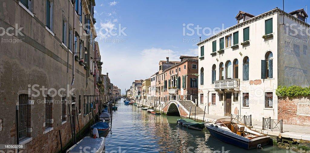 Venice quiet canals bridges boats stucco villas summer panorama Italy royalty-free stock photo