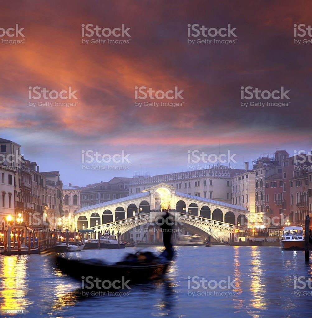 Venice, Rialto bridge and with gondola on Grand Canal, Italy stock photo