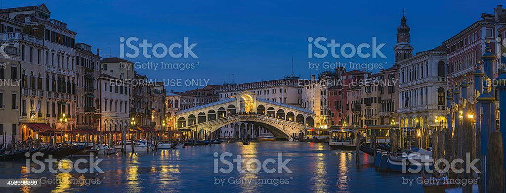 Venice Rialto Bridge Grand Canal restaurant illuminated at dusk Italy royalty-free stock photo