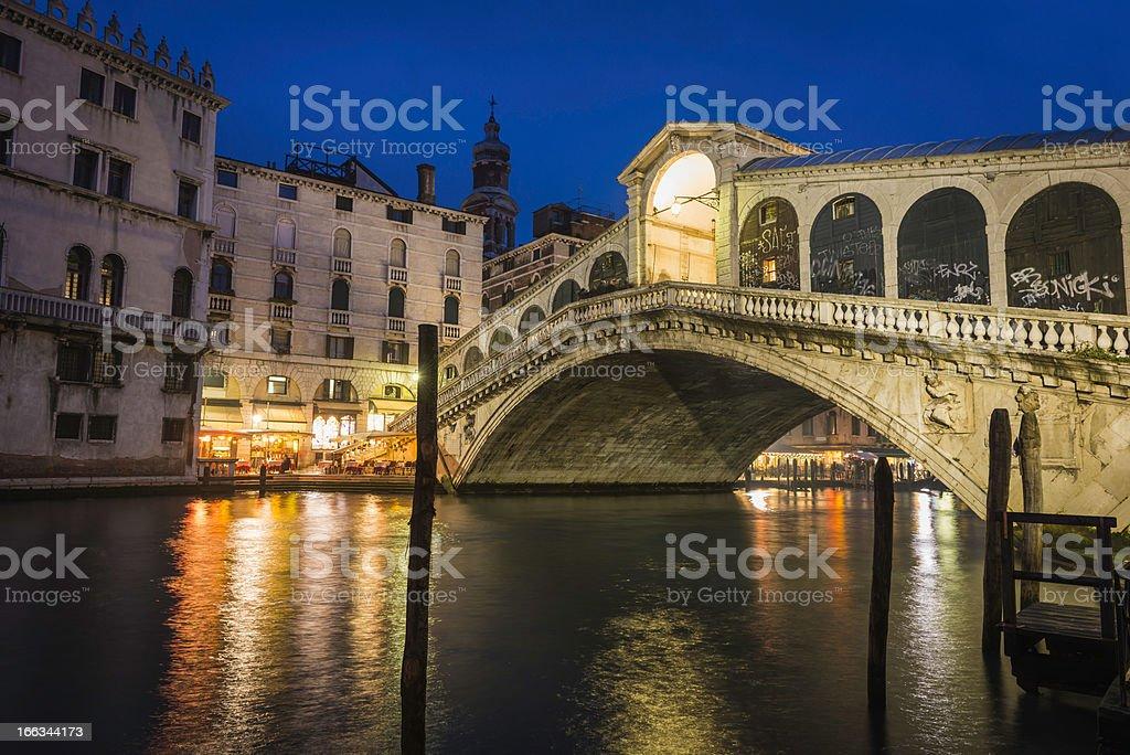 Venice Rialto Bridge Grand Canal restaurants illuminated at night Italy royalty-free stock photo