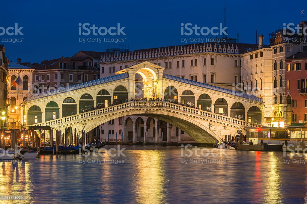 Venice Rialto Bridge illuminated over Grand Canal at dusk Italy royalty-free stock photo