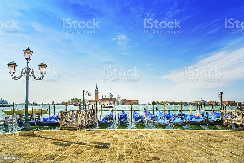 Venice, street lamp, gondolas and church on background. Italy royalty-free stock photo
