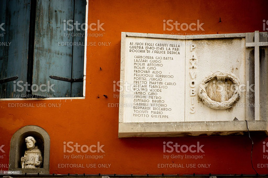 Venice street with list of names on a carved plaque stock photo