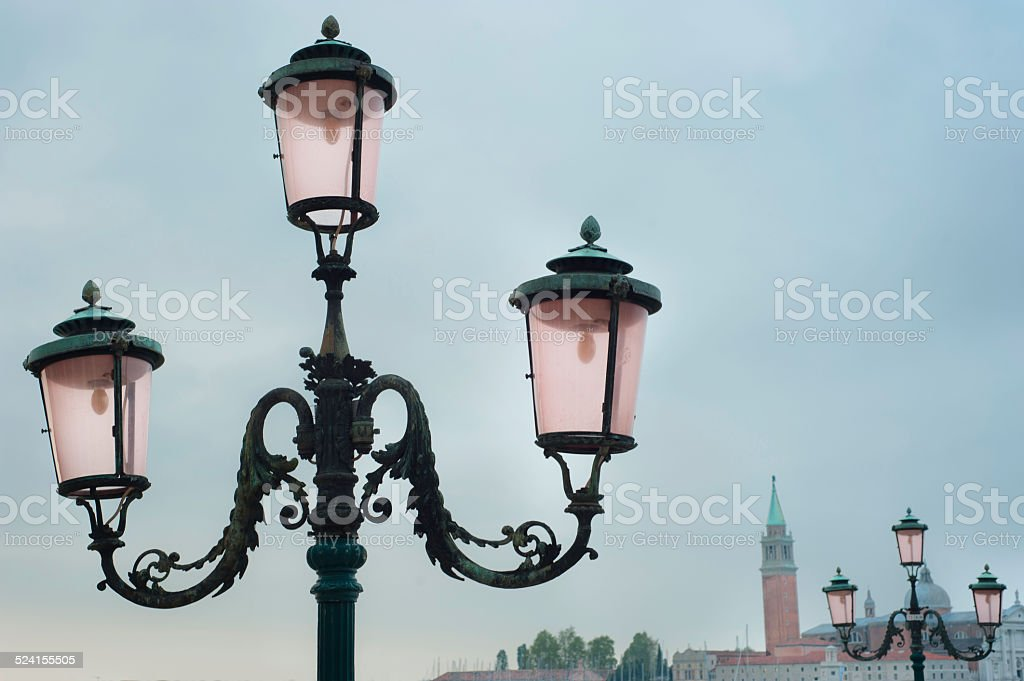 Venice streetlamp and skyline stock photo