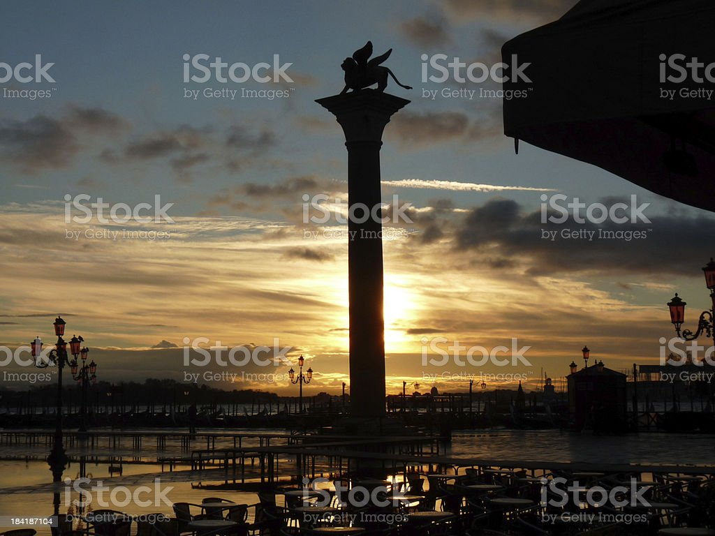 Venice Sunset over Winged Lion of St. Mark royalty-free stock photo