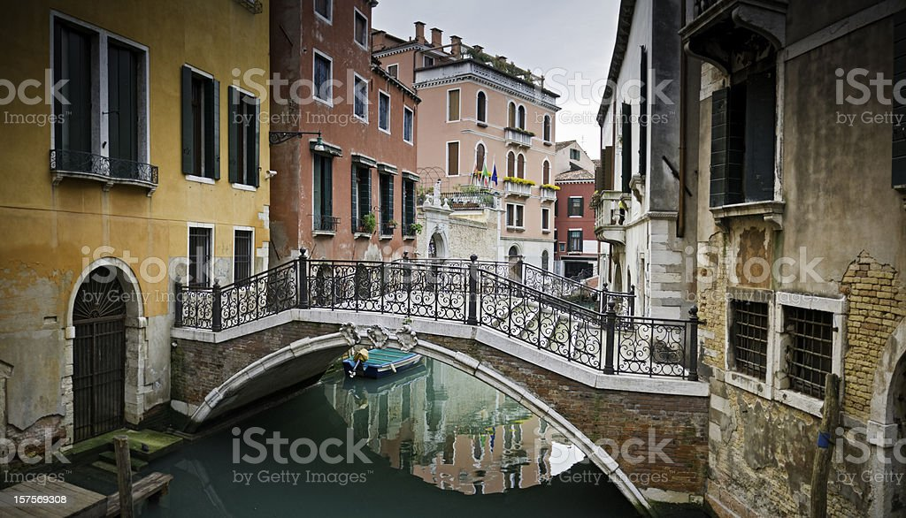 Venice tranquil canals colorful stucco villas pretty footbridge Veneto Italy royalty-free stock photo