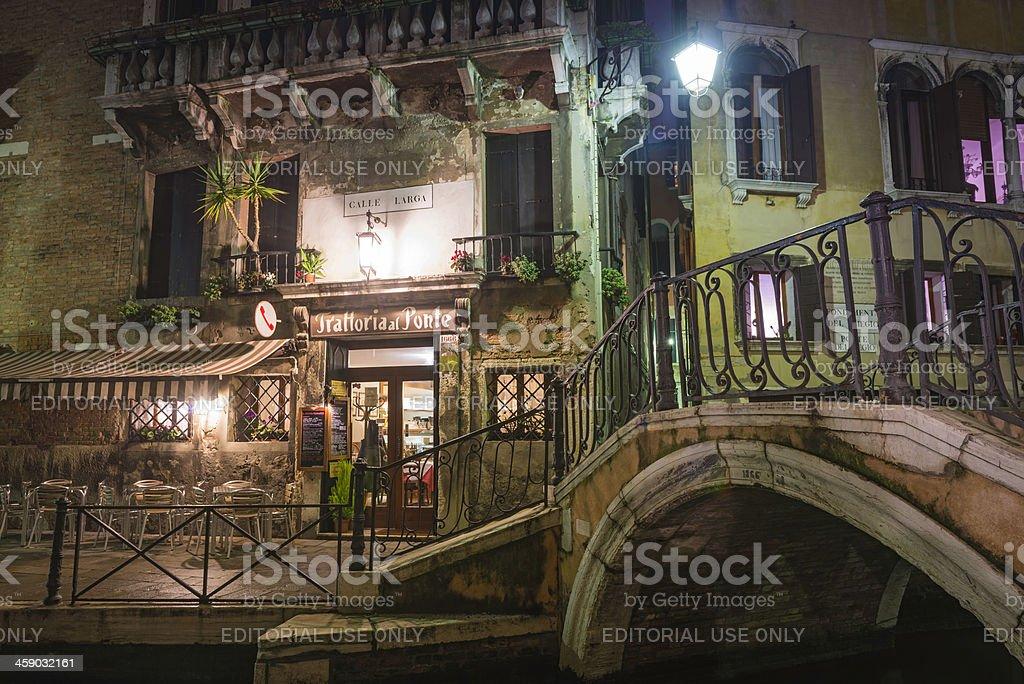 Venice tranquil canals warm cafes illuminated at night Italy royalty-free stock photo
