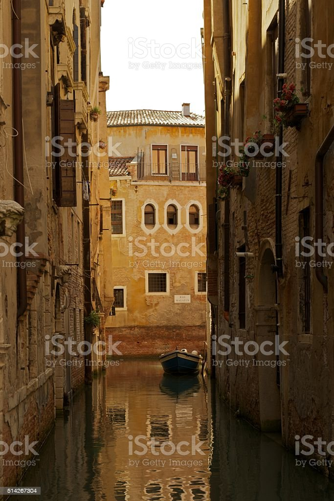 Venice Venetto Canal with boat and water reflections stock photo