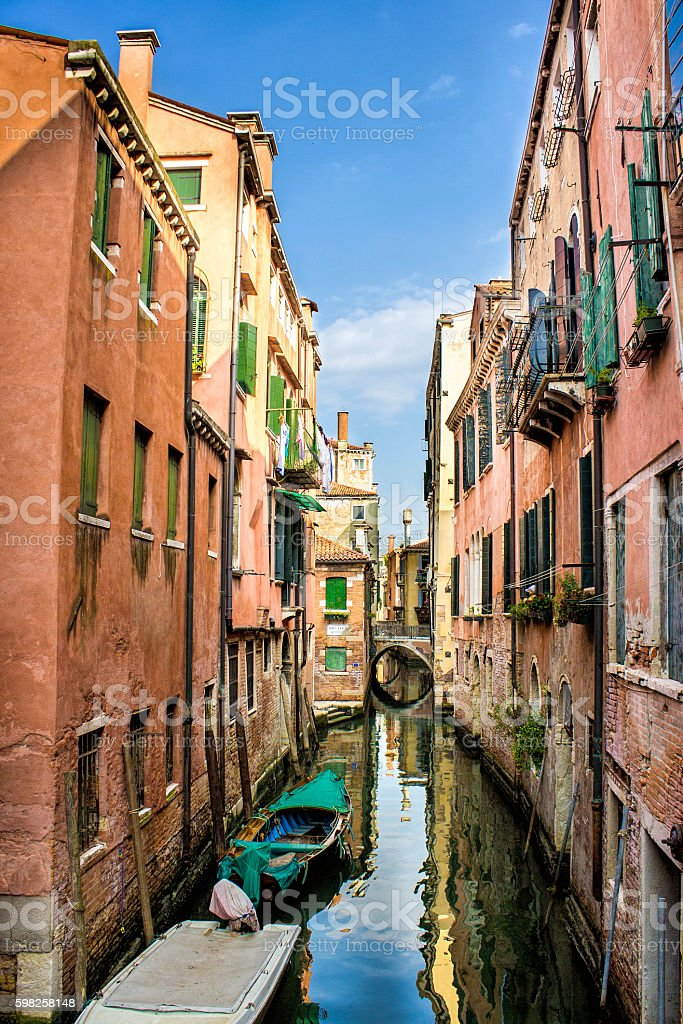 Venice with boats in day time under cloudy sky stock photo