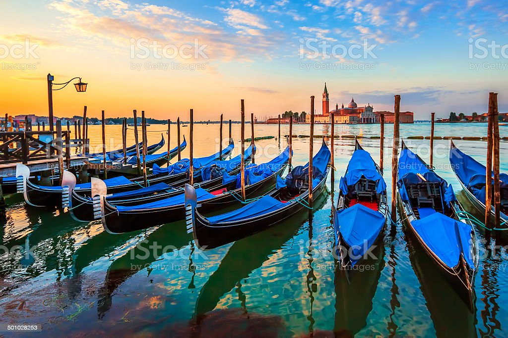 Venice with famous gondolas at sunrise stock photo