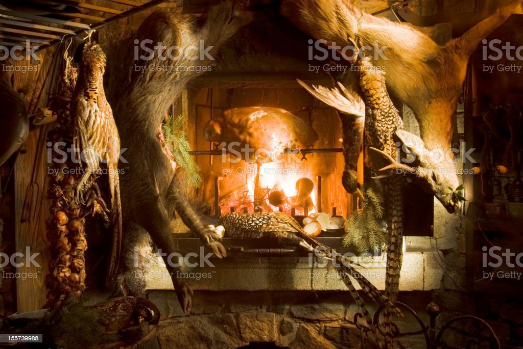 Venison hanging at a fireplace royalty-free stock photo