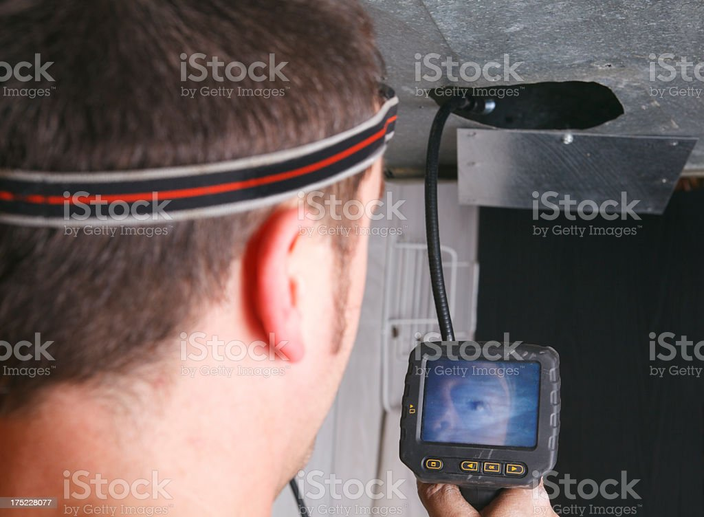 Ventilation Cleaner - Find Dust Camera stock photo