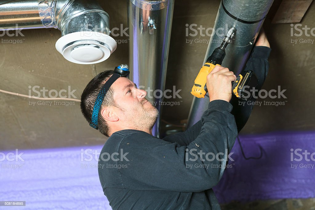 Ventilation Cleaner - Worker stock photo
