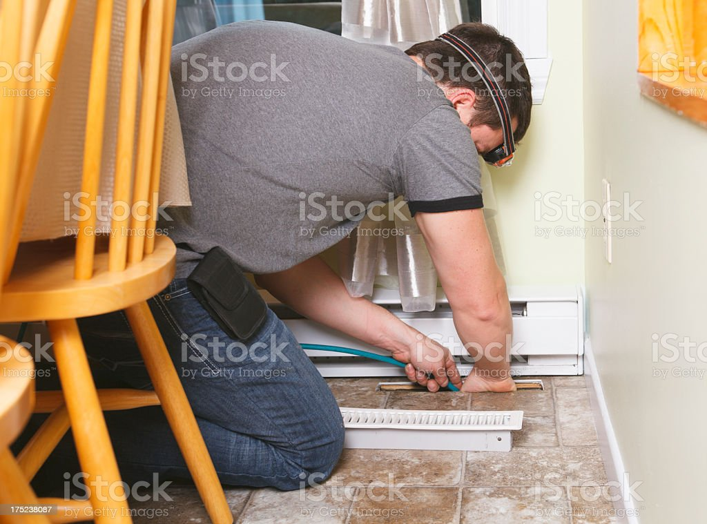 Ventilation Cleaner - Working on stock photo