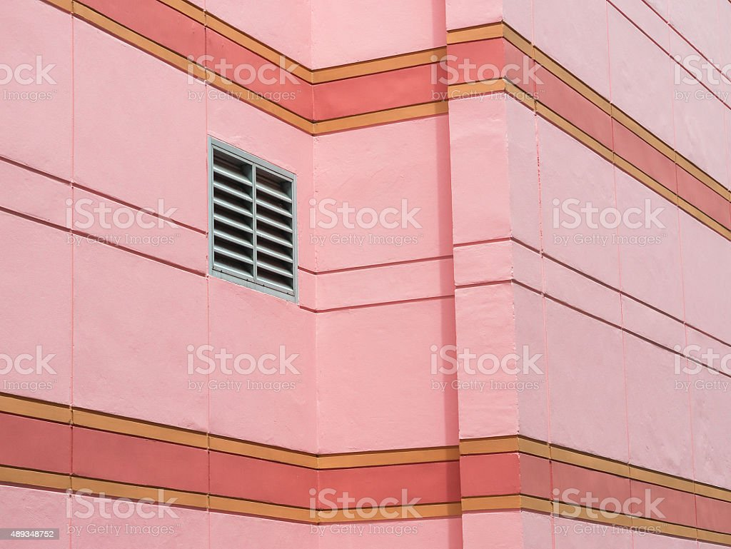 Ventilation grille mounted on pink wall of building. royalty-free stock photo