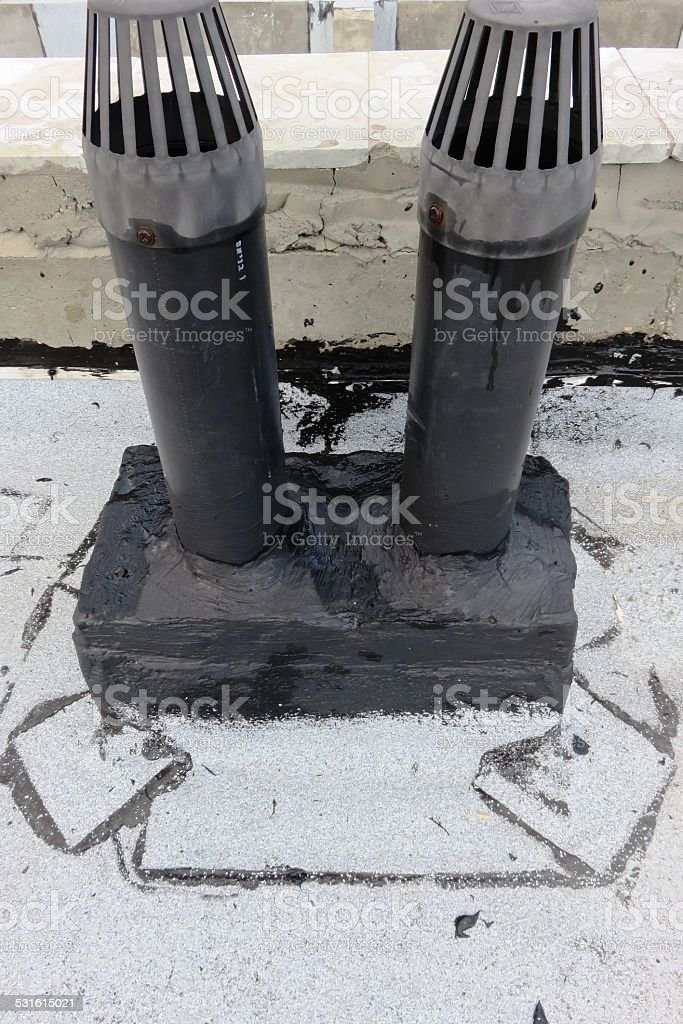 Ventilation pipe and tar stock photo